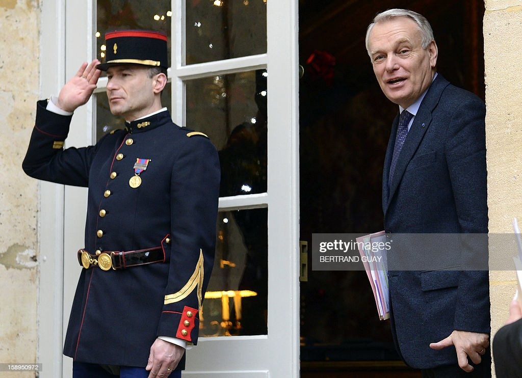 French Prime Minister Jean-Marc Ayrault arrives to take part in a government seminar focusing on the government's agenda for the coming year on January 4, 2013 at the Hotel Matignon in Paris.