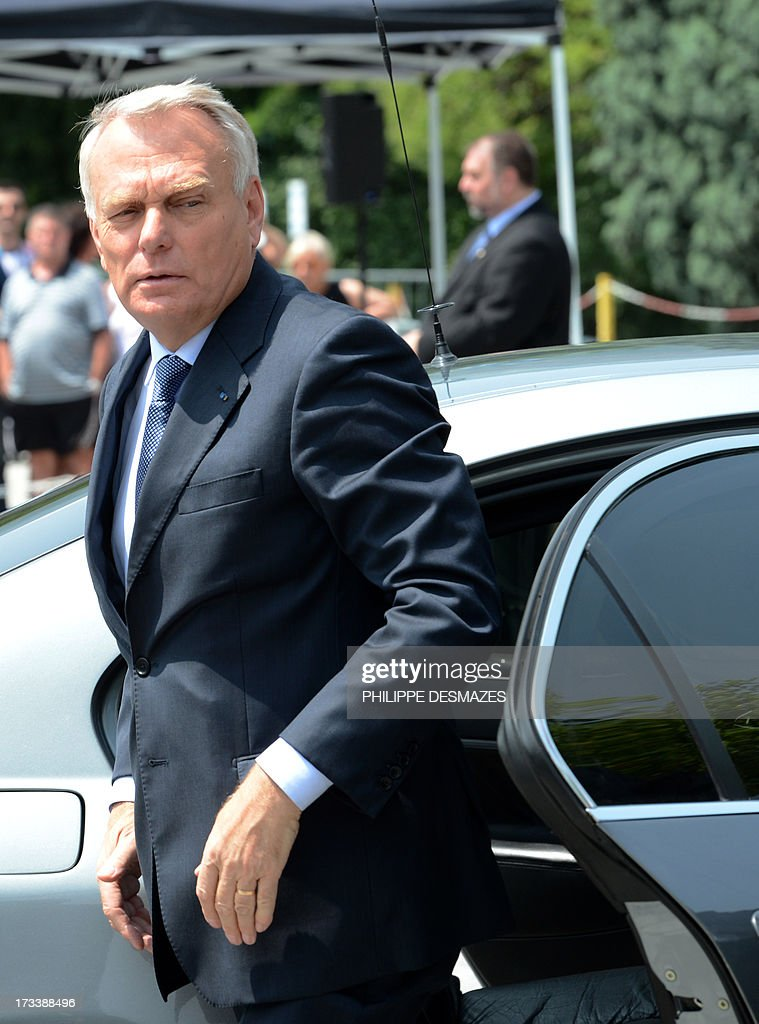 French Prime minister Jean-Marc Ayrault arrives to visit the Rio Tinto Alcan (RTA) aluminum factory in Saint-Jean-de-Maurienne, southeast of France, on July 13, 2013. Heads of Rio Tinto Alcan and Germany's Trimet met today in Paris regarding the take over of RTA by Trimet which could save 510 jobs at the two sites of Saint-Jean-de-Maurienne (Savoie) and Castelsarrasin (Tarn-et-Garonne) .
