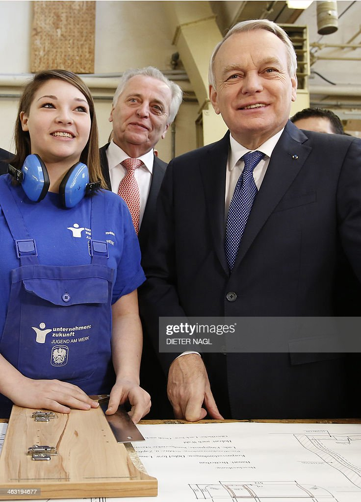 French Prime Minister Jean-Marc Ayrault (R) Austrian apprentice Tara Jaeger (R) and Austrian Social affairs Minister Rudolf Hundstorfer (C) pose during a visit to the 'Jugend am Werk' (Youth at Work) workshop, an Austrian Government initative on January 17, 2014 in Vienna. The French Prime Minister is on an official two day visit in Austria.