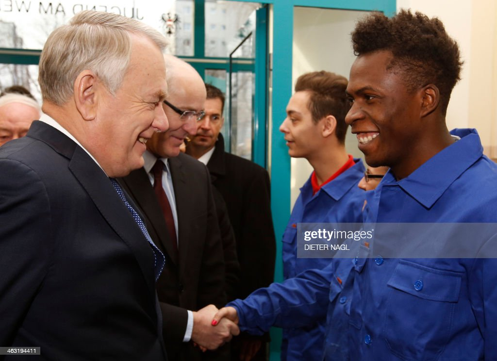 French Prime Minister Jean-Marc Ayrault chats with Austrian apprentice Amani Issa during a visit to the 'Jugend am Werk' (Youth at Work) workshop, an Austrian Government initative on January 17, 2014 in Vienna. The French Prime Minister is on an official two day visit in Austria.