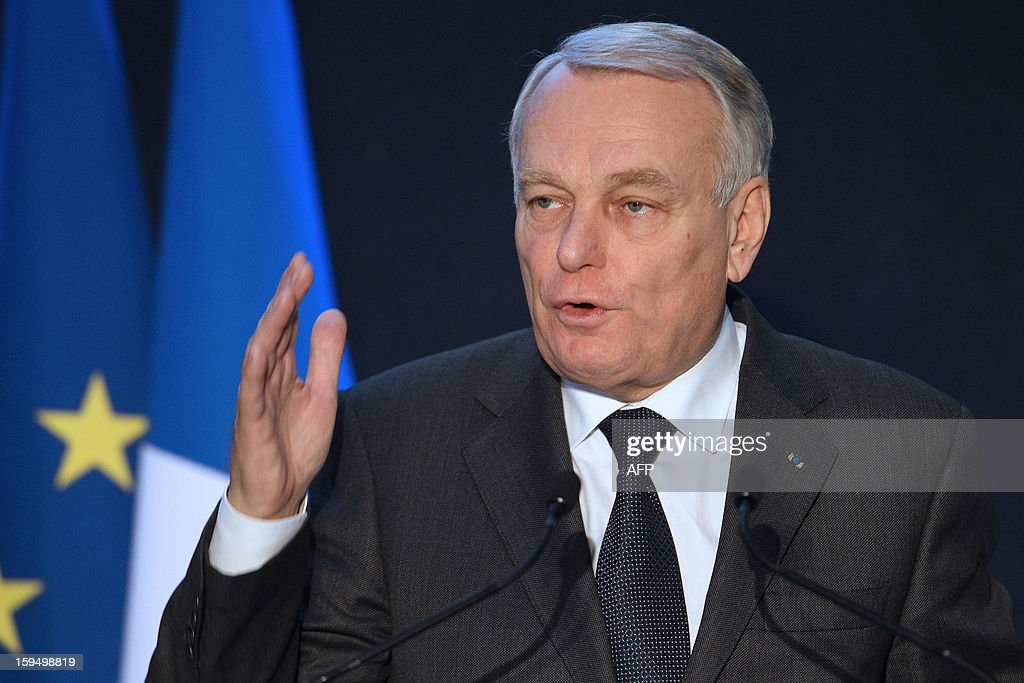 French Prime Minister Jean-Marc Ayrault delivers a speech after a visit in a center for adult learning (Afpa - formation pour adultes), on January 14, 2013 in Caen, Normandy. AFP PHOTO / CHARLY TRIBALLEAU