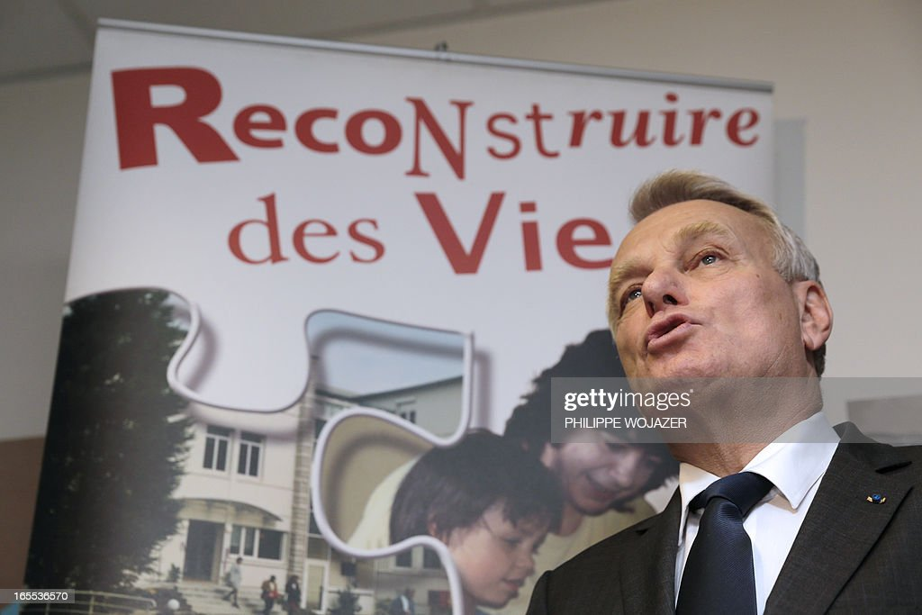 French Prime Minister Jean-Marc Ayrault delivers a speech at the end of a visit of a Salvation Army emergency lodging centre in Paris on April 4, 2013.