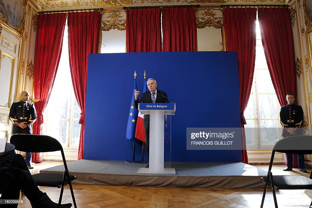 French Prime Minister Jean-Marc Ayrault (C) delivers a speech following a lunch with French government's ministers focused on budget on February 20, 2013 at the Hotel Matignon, the Prime Minister official residence, in Paris.