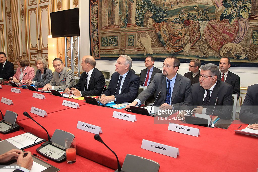 French Prime Minister Jean-Marc Ayrault (3rdR, first raw) flanked by Defense Minister Jean-Yves Le Drian (4thR) and General Pierre de Villiers (4thL), Major general of the French Army, attend a meeting with political groups and committees MPs, on January 28, 2013, in Paris, at the Hotel Matignon, the Prime Minister official residence, to inform the French representatives on the situation in Mali. French authorities has engaged French troops to back Malian army since January 11 to launch an offensive against Islamist rebels. At right, Junior Minister for Parliament relation Alain Vidalies, 2nd right, Ayrault's chief of staff Christophe Chantepy. AFP PHOTO PIERRE VERDY
