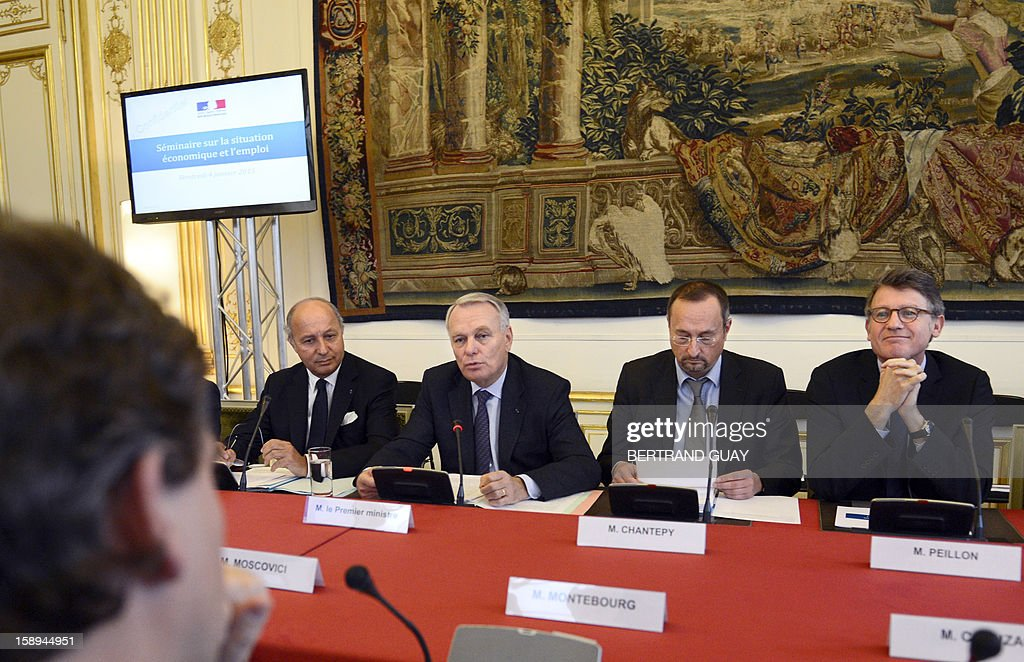 French Prime Minister Jean-Marc Ayrault (C), flanked by his chief of staff Christophe Chantepy (C,R) and surrounded by French Minister of Foreing Affairs, Laurent Fabius (L) and French Education Minister Vincent Peillon (R), speaks during a seminar with French ministers, focused on French government's agenda for the coming year, on January 4, 2013 at the Hotel Matignon in Paris. AFP PHOTO BERTRAND GUAY