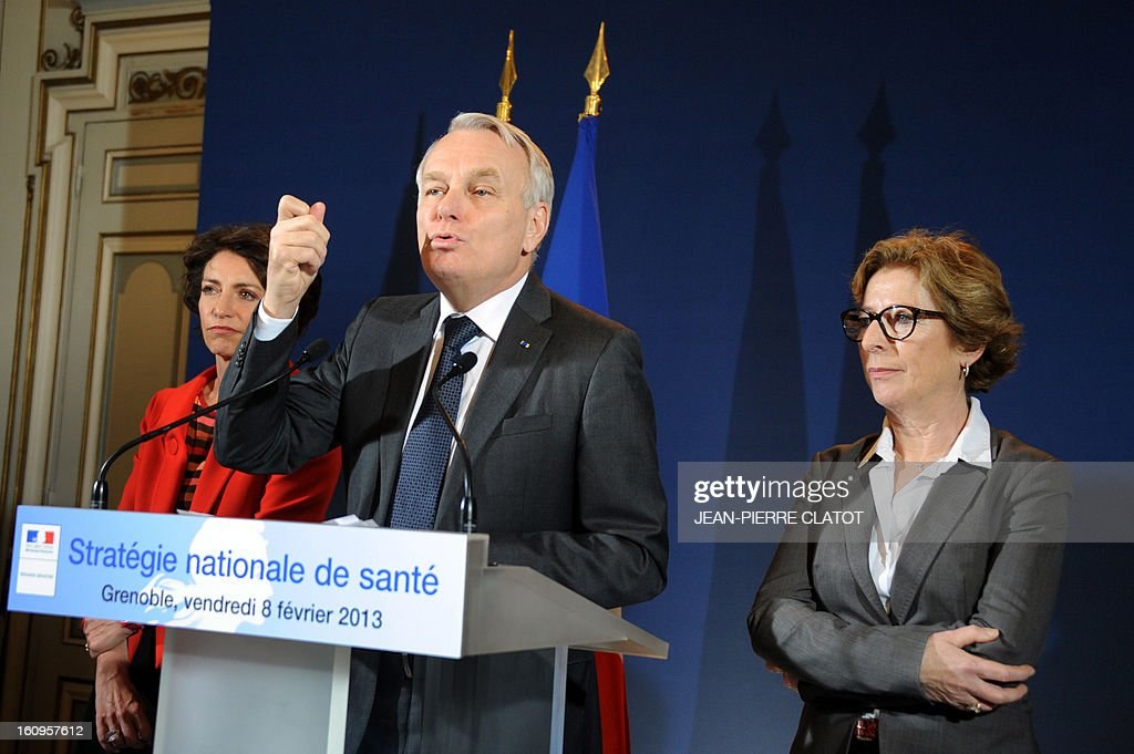 French Prime Minister Jean-Marc Ayrault (C) flanked by Social Affairs and Health Minister, Marisol Touraine (L) and Minister for Higher Education and Research Genevieve Fioraso, gestures as he delivers a speech focused on the government's health strategy at the Grenoble Prefecture, French Alps, on February 8, 2013.
