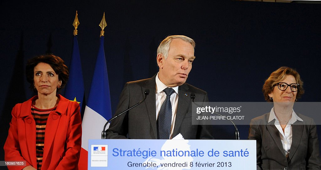 French Prime Minister Jean-Marc Ayrault (C) flanked by Social Affairs and Health Minister, Marisol Touraine (L) and Minister for Higher Education and Research Genevieve Fioraso, delivers a speech focused on the government's health strategy at the Grenoble Prefecture, French Alps, on February 8, 2013.