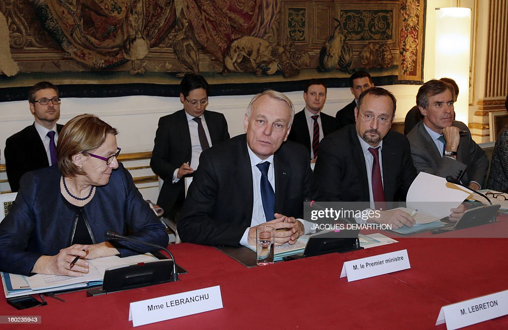 French Prime Minister Jean-Marc Ayrault (2ndL), flanked French Minister for State Reform, Decentralisation and Public Administration Marylise Lebranchu (L), Ayrault's chief of staff Christophe Chantepy (2ndR), France's Junior Minister for Budget, Jerome Cahuzac (R) heads, on January 28, 2013, in Paris, at the Hotel Matignon, the Prime Minister official residence, a meeting for the creation of a working committee between French State and departements of France.