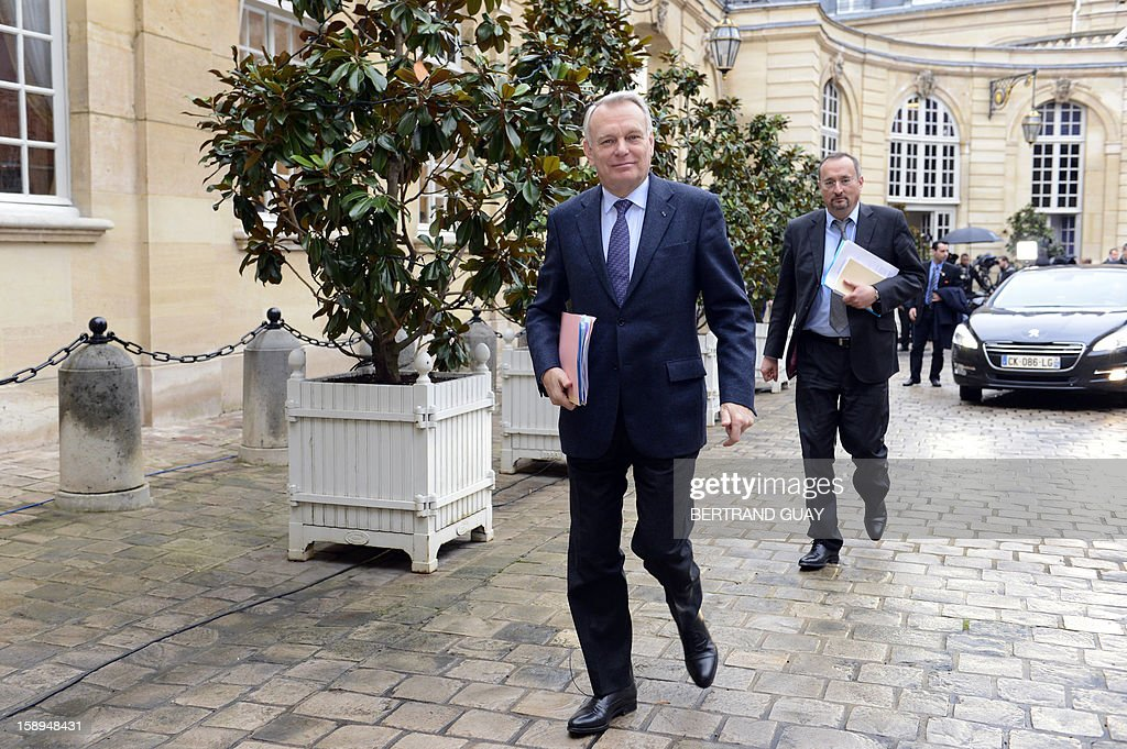 French Prime Minister Jean-Marc Ayrault (L), followed by his chief of staff Christophe Chantepy, arrives on January 4, 2013 at the Hotel Matignon in Paris, prior to attend with French ministers a seminar focused on French government's agenda for the coming year.