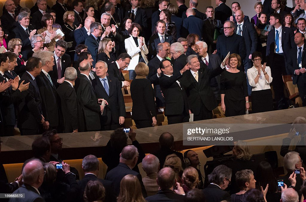 French Prime Minister Jean-Marc Ayrault (7th L), German Chancellor Angela Merkel (C) French President Francois Hollande (C-R), German President Joachim Gauck (3rd R) and his partner Daniela Schadt (2nd L) and members of the German and French arrive arrive for a concert at the Berliner Philarmonie Concert Hall on January 22, 2013 in Berlin, Germany as part of the celebrations marking the 50 years of the Elysee Treaty, a French-German cooperation launched after WWII.In signing the landmark treaty on January 22, 1963, then French president Charles de Gaulle and West German chancellor Konrad Adenauer sealed a new era of reconciliation between the former foes which has since driven European unity.