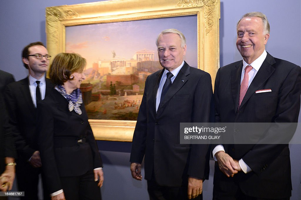 French Prime Minister Jean-Marc Ayrault (C), German Culture Minister Bernd Neumann (R), and Brigittte Ayrault pose on March 26, 2013 during their visit of the exhibition 'De l'Allemagne, 1800-1939 - From Friedrich to Beckmann' at the Louvre museum in Paris .