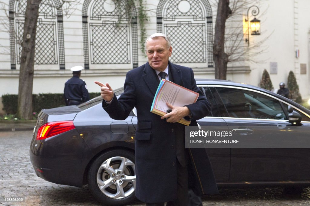 French Prime Minister, Jean-Marc Ayrault gestures as he arrives at the Ministry of Interior to attend a breakfast with ministers on January 3, 2013 in Paris, prior to first cabinet meeting of the year.