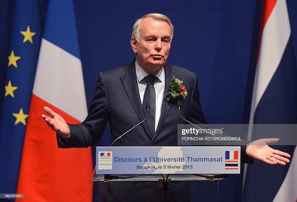 French Prime Minister Jean-Marc Ayrault gestures as speaks during a visit to Thammasat University in Bangkok on February 5, 2013. Ayrault is on two-day official visit to Thailand.