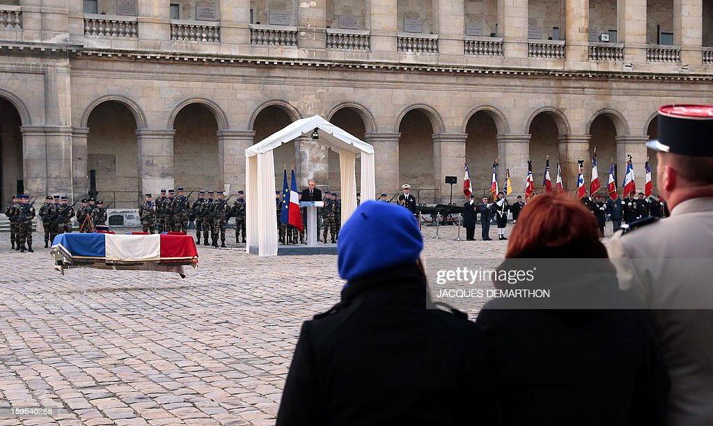 French Prime Minister Jean-Marc Ayrault gives a speech during a funeral service for French air force lieutenant Damien Boiteux at the Invalides courtyard in Paris, on January 15, 2013. French pilot Damien Boiteux was killed on January 11 during a helicopter raid launched to support Mali ground troops in the battle for the key town of Kona, and to prevent Islamist groups controlling northern Mali from advancing toward the capital Bamako. AFP PHOTO / POOL / JACQUES DEMARTHON