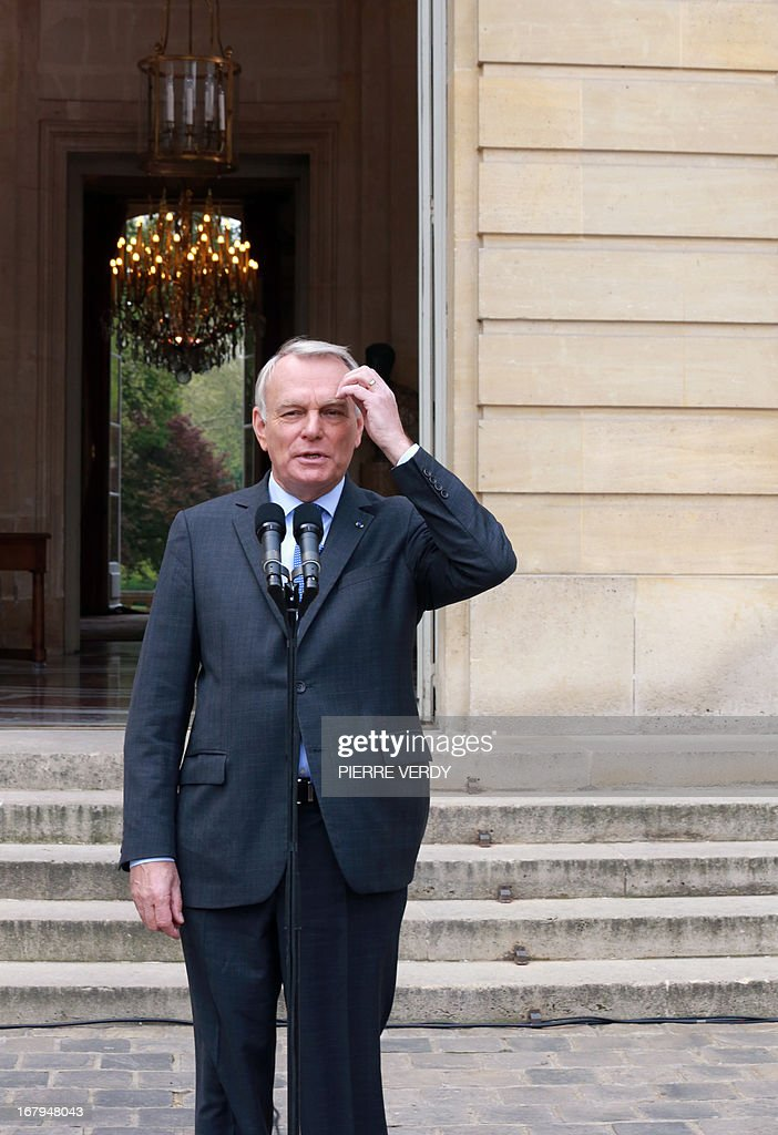 French Prime minister Jean-Marc Ayrault gives a speech in the yard of the Hotel Matignon, the Prime Ministrer's official residence, on May 3, 2013 in Paris, after a work seminar with administrative officials of the ministries. AFP PHOTO/PIERRE VERDY