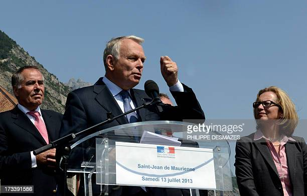 French Prime minister JeanMarc Ayrault gives a speech next to Rio Tinto Alcan chief executive officer Jacynte Côte and president of Trimet HeinzPeter...