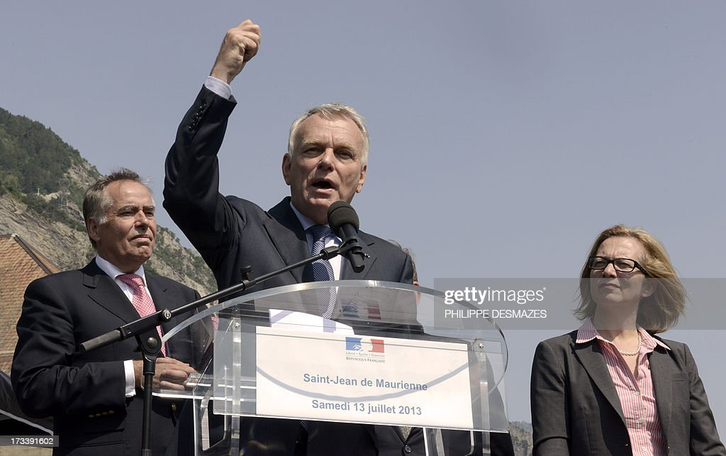 French Prime minister Jean-Marc Ayrault (C) gives a speech next to Rio Tinto Alcan chief executive officer Jacynte Côte (R) and president of Trimet Heinz-Peter Schlüter (L) on July 13, 2013 at the Rio Tinto Alcan (RTA) aluminum factory in Saint-Jean-de-Maurienne, southeast of France. Heads of Rio Tinto Alcan and Germany's Trimet signed a contract on July 13 regarding the take over of RTA by Trimet which will save 510 jobs at the two sites of Saint-Jean-de-Maurienne and Castelsarrasin.