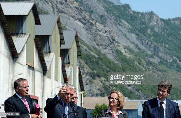 French Prime minister JeanMarc Ayrault gives a speech next to Rio Tinto Alcan chief executive officer Jacynte Côte French Minister for Industrial...