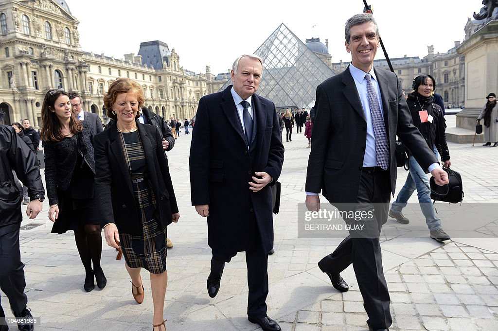 French Prime Minister Jean-Marc Ayrault (C), his wife Brigitte (2ndL) and Louvre President Henri Loyrette (R) leave on March 26, 2013 after a visit of the exhibition 'De l'Allemagne, 1800-1939 - From Friedrich to Beckmann' at the Louvre museum in Paris .