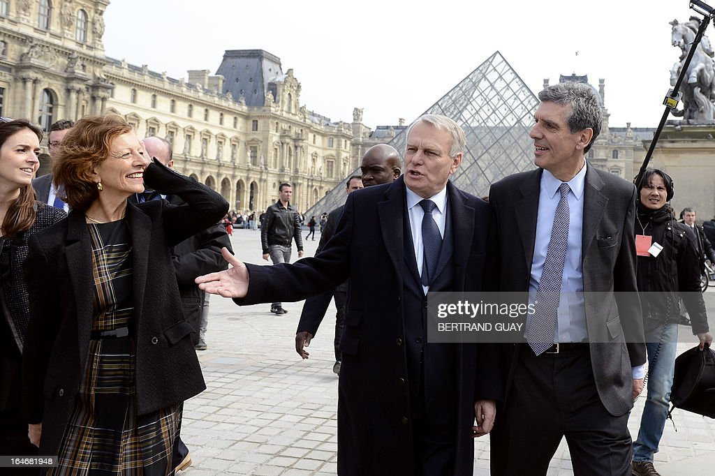 French Prime Minister Jean-Marc Ayrault (C), his wife Brigitte (2ndL) and Louvre President Henri Loyrette (R) chat as they leave on March 26, 2013 after a visit of the exhibition 'De l'Allemagne, 1800-1939 - From Friedrich to Beckmann' at the Louvre museum in Paris .