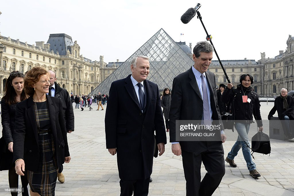 French Prime Minister Jean-Marc Ayrault (C), his wife Brigitte (2ndL) and Louvre President Henri Loyrette (R) leave on March 26, 2013 after a visit of the exhibition 'De l'Allemagne, 1800-1939 - From Friedrich to Beckmann' at the Louvre museum in Paris . AFP PHOTO / POOL / BERTRAND GUAY