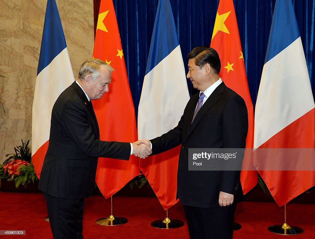 French Prime Minister <a gi-track='captionPersonalityLinkClicked' href=/galleries/search?phrase=Jean-Marc+Ayrault&family=editorial&specificpeople=551961 ng-click='$event.stopPropagation()'>Jean-Marc Ayrault</a> (L) is greeted by the Chinese President <a gi-track='captionPersonalityLinkClicked' href=/galleries/search?phrase=Xi+Jinping&family=editorial&specificpeople=2598986 ng-click='$event.stopPropagation()'>Xi Jinping</a> (R) during their meeting inside the Great Hall of the People on December 6, 2013 in Beijing, CHina. Ayrault who is on a four day visit to China will meet Chinese leaders in Beijing and travel to the cities of Wuhan and Guangzhou.