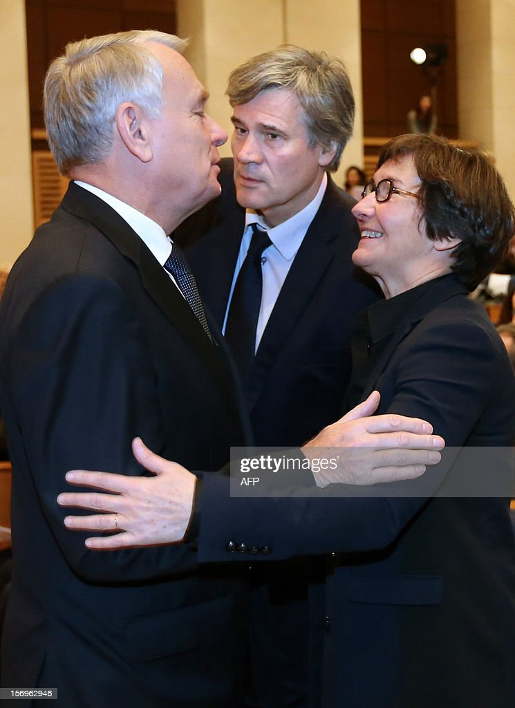 French Prime minister Jean-Marc Ayrault (L) is welcomed by French Agriculture Minister Stephane Le Foll (C) and French Sports and Youth Minister Valerie Fourneyron, on November 26, 2012 at the elite research institution College de France in Paris, as he arrives to attend the opening of the meeting for Higher Education and Research.