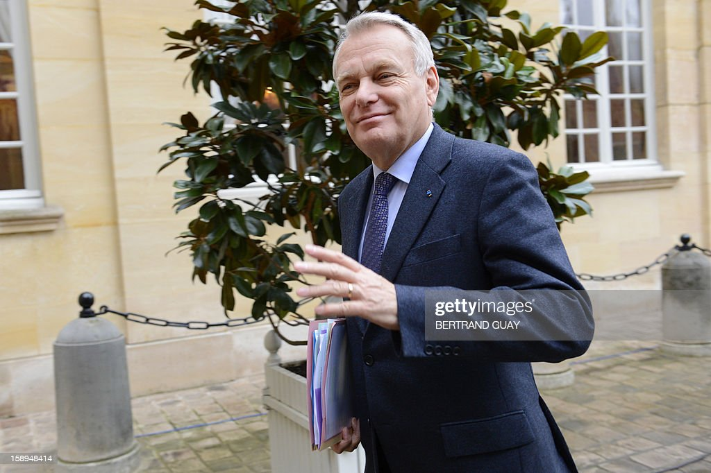 French Prime Minister Jean-Marc Ayrault looks on upon his arrival on January 4, 2013 at the Hotel Matignon in Paris, prior to attend with French ministers a seminar focused on French government's agenda for the coming year.