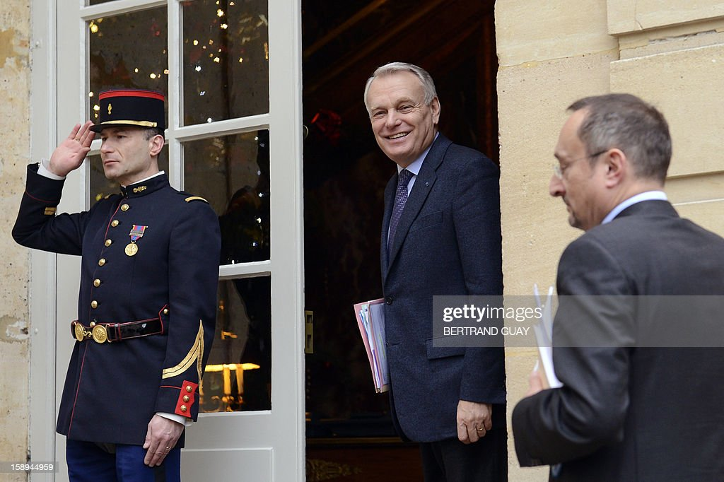 French Prime Minister Jean-Marc Ayrault (C) looks on upon his arrival prior to attend with French ministers a seminar focused on French government's agenda for the coming year, on January 4, 2013 at the Hotel Matignon in Paris.