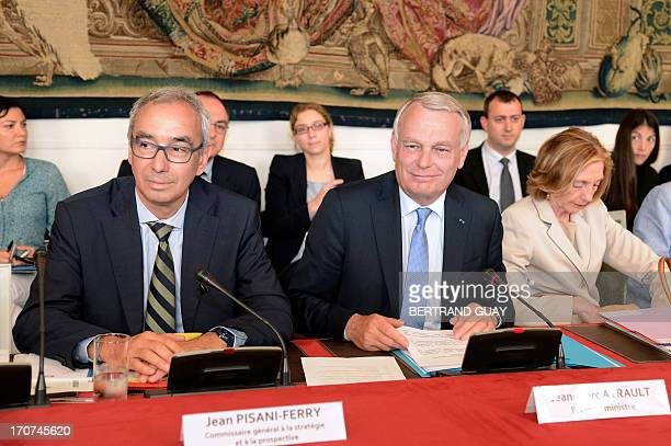 French Prime Minister JeanMarc Ayrault next to Jean PisaniFerry French economist Commissioner General to the strategy and foresight and Nicole Bricq...