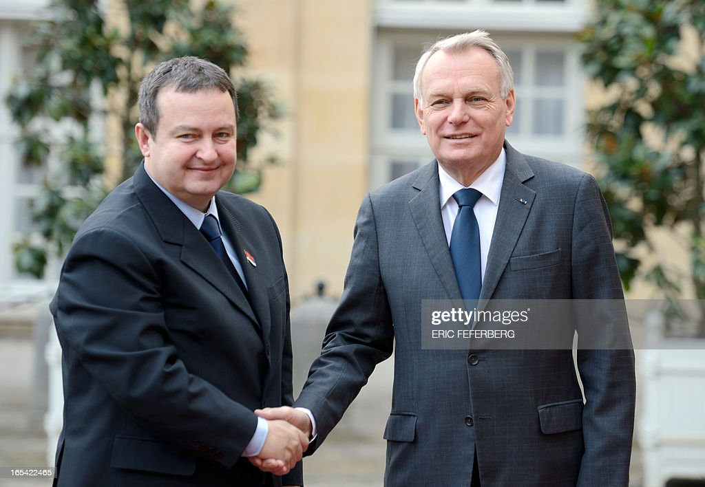 French Prime Minister Jean-Marc Ayrault (R) shakes hand with Serbian Prime Minister Ivaca Dacic at Matignon Hotel on April 4, 2013 in Paris.