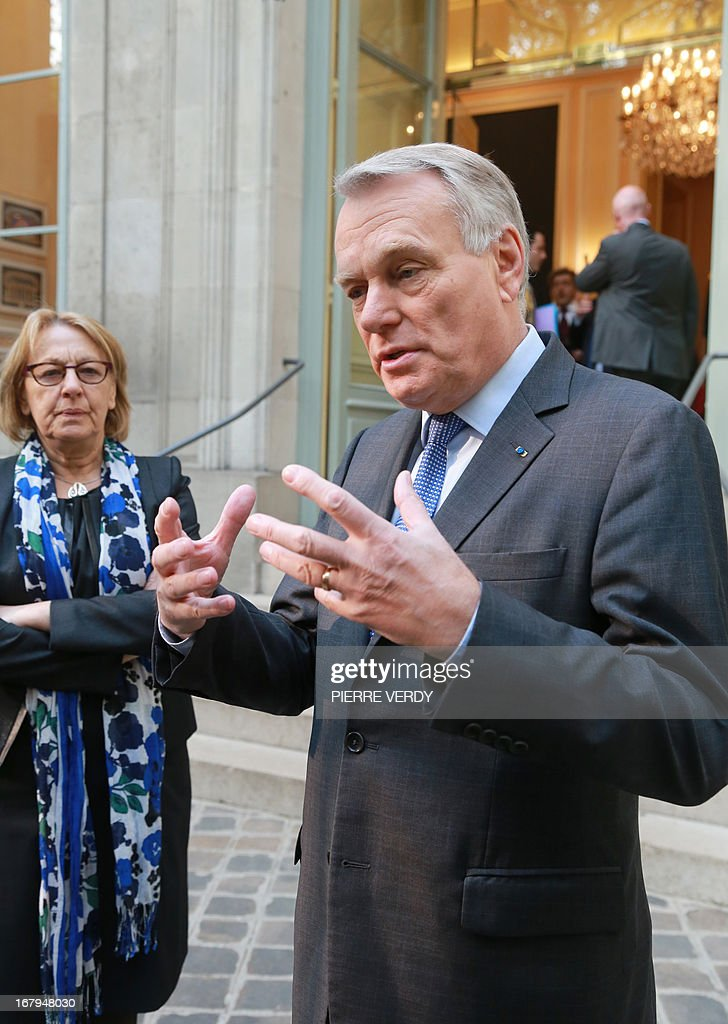 French Prime minister Jean-Marc Ayrault (R) speaks in front of the Maison de l'Amérique Latine (Latin American House) as Marylise Lebranchu, the minister of State Reform, decentralisation, and public function, looks on, on May 3, 2013 in Paris after a work seminar with administrative officials of the ministries.