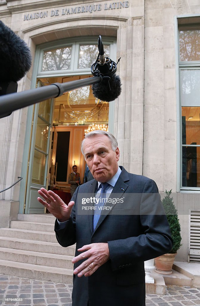 French Prime minister Jean-Marc Ayrault speaks in front of the Maison de l'Amérique Latine (Latin American House) on May 3, 2013 in Paris after a work seminar with administrative officials of the ministries AFP PHOTO/PIERRE VERDY