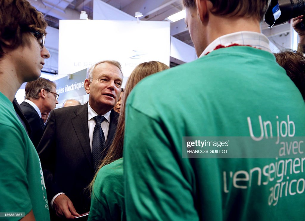 French Prime Minister Jean-Marc Ayrault (C) speaks to participants at a European education convention in Paris on November 23, 2012.