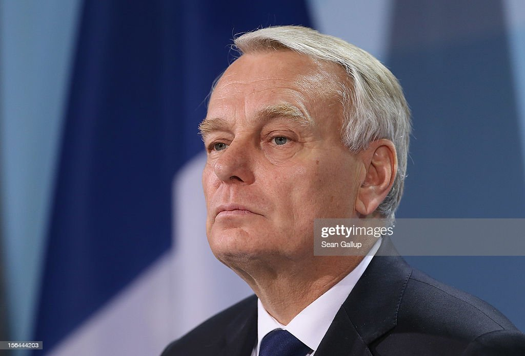 French Prime Minister <a gi-track='captionPersonalityLinkClicked' href=/galleries/search?phrase=Jean-Marc+Ayrault&family=editorial&specificpeople=551961 ng-click='$event.stopPropagation()'>Jean-Marc Ayrault</a> speaks to the media with German Chancellor Angela Merkel (not pictured) following talks at the Chancellery on November 15, 2012 in Berlin, Germany. Ayrault is meeting with Merkel to discuss the Eurozone's ongoing economic crisis as the region officially slipped into recession today.