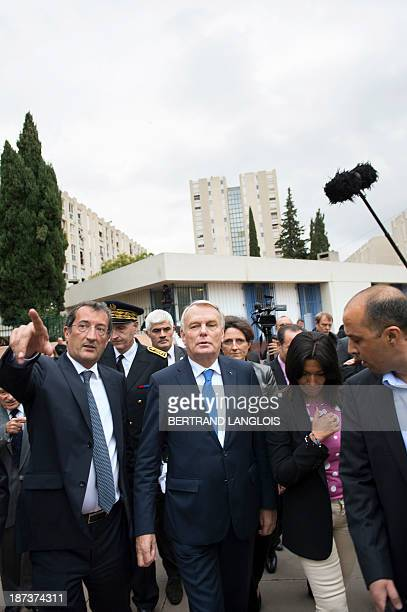 French Prime Minister JeanMarc Ayrault speaks with French Junior Minister for Cities Francois Lamy and French senator and socialist primaries for the...