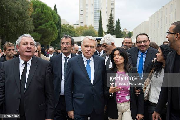 French Prime Minister JeanMarc Ayrault speaks with French Junior Minister for Cities Francois Lamy French senator and socialist primaries for the...