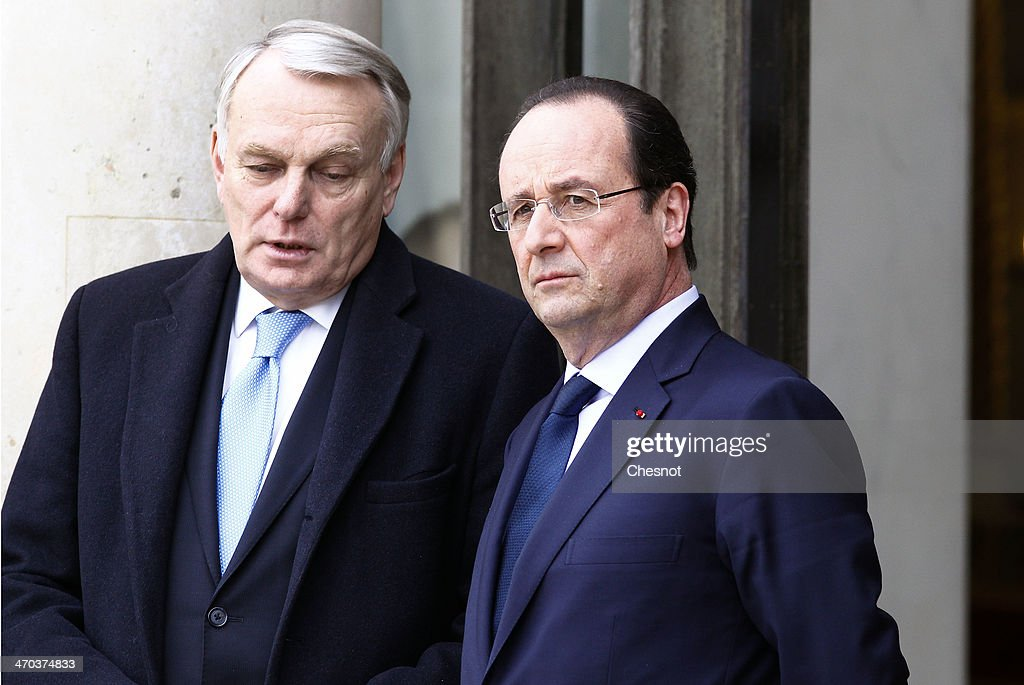 French Prime Minister, <a gi-track='captionPersonalityLinkClicked' href=/galleries/search?phrase=Jean-Marc+Ayrault&family=editorial&specificpeople=551961 ng-click='$event.stopPropagation()'>Jean-Marc Ayrault</a> (L) speaks with French president Francois Hollande (R) at the presidential Elysee Palace after a joint press conference with the German Chancellor on February 19, 2014, in Paris, France. Germany and France on February 19 strongly condemned the deadly violence in Ukraine, with President Francois Hollande urging sanctions and Chancellor Angela Merkel expressing solidarity with protestors. 'There are unspeakable, unacceptable, intolerable acts being carried out in Ukraine,' Hollande said at a joint press conference with his German counterpart in Paris.