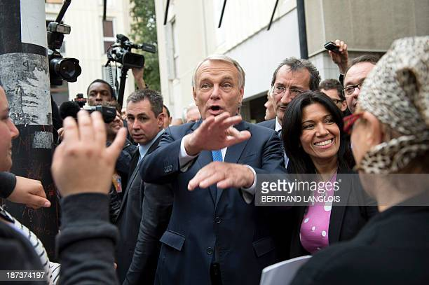 French Prime Minister JeanMarc Ayrault speaks with French senator and socialist primaries for the Marseille 2014 municipal election's unsuccessful...