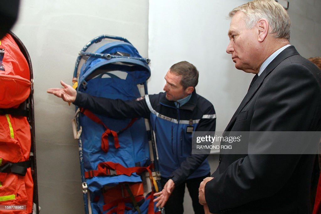 French Prime minister Jean-Marc Ayrault (R) speaks with gendarmes and police officers in charge of mountain rescue operations during a visit at the Font-Romeu gendarmes headquarters, southern France, on December 28, 2012. AFP PHOTO / RAYMOND ROIG