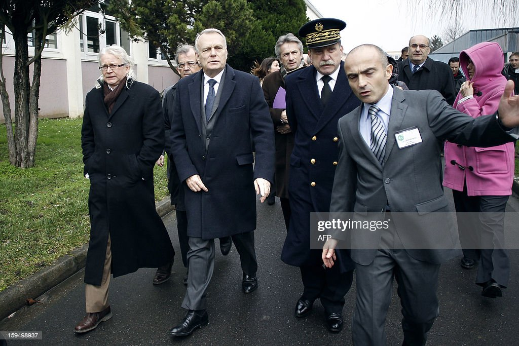 French Prime Minister Jean-Marc Ayrault (2nd L) visit a center for adult learning (Afpa - formation pour adultes) with Calvados and Basse Normandie Prefect Michel Lalande (2nd R) and the center's director Cyril Barranco (R), , on January 14, 2013 in Caen, Normandy.