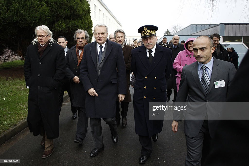 French Prime Minister Jean-Marc Ayrault (3rd R) visits a center for adult learning (Afpa - formation pour adultes) with Calvados and Basse Normandie Prefect Michel Lalande (2nd R) and the center's director Cyril Barranco (R), on January 14, 2013 in Caen, Normandy.