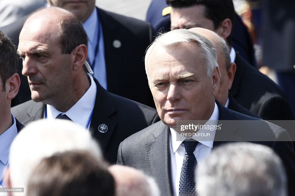 French Prime Minister Jean-Marc Ayrault walks during the Bastille Day parade on the Champs Elysees, on July 14, 2013 in Paris. AFP PHOTO / FRED DUFOUR