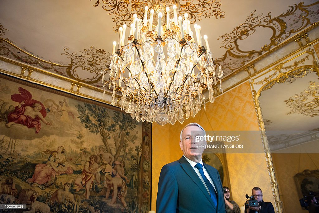 French Prime Minister Jean-Marc Ayrault welcomes visitors in the yellow reception room (Salon Jaune in French), on September 15, 2012, at the Hotel Matignon, French Prime Minister's official residence, in Paris, during the 29th edition of France's European heritage open days. France opens the doors of its state buildings, some usually forbidden to the public, during these European heritage days until September 16. As part of this year's edition, Hotel Matignon unveils the desk of French socialist statesman and former Prime Minister Leon Blum (1872-1950) displayed in the yellow reception room, on which Blum signed the Matignon Agreements on June 1936.