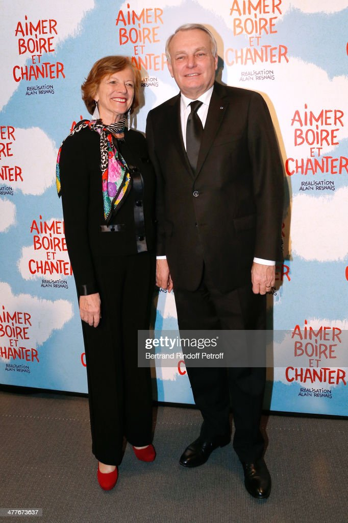 French Prime Minister Jean-Marc Ayrault with his wife Brigitte Ayrault attend the 'Aimer, Boire Et Chanter' Paris movie premiere. Held at Cinema UGC Normandie on March 10, 2014 in Paris, France.