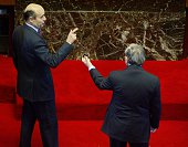 French Prime minister JeanPierre Raffarin chats with French UMP president Alain Juppé 22 January 2003 in the congressional chamber of the palace of...