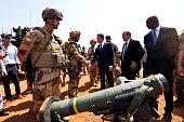 French Prime Minister Manuel Valls accompanied by French Defence Minister JeanYves Le Drian and Mali Defence Minister Tieman Hubert Coulibaly salutes...