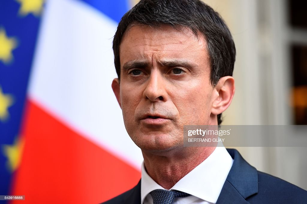 French Prime Minister Manuel Valls addresses the media after a series of meetings with heads and delegates of France's employers' unions Medef, CGPME, CFE-CGC and UPA and the French Labour minister on June 30, 2016 at the Hotel Matignon in Paris. Manuel Valls failed to narrow differences about the labour law reform , as Medef expressed its 'disappointment' and unions opposed to the draft were calling for further mobilization during the upcoming debate at the French National Assembly, where the use of the constitution's controversial Article 49.3, allowing the government to bypass parliament, might be expected. / AFP / BERTRAND