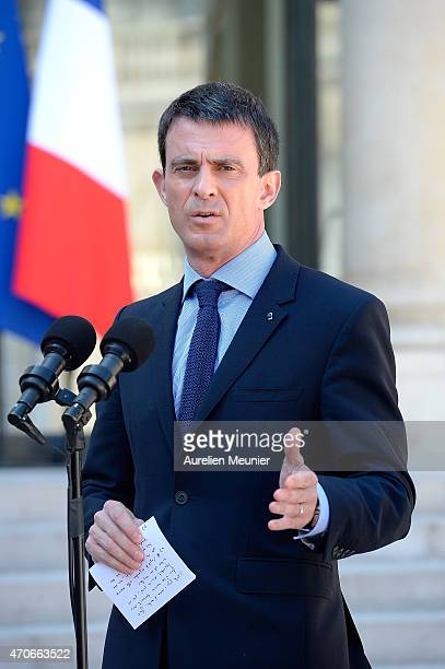 French Prime Minister Manuel Valls addresses the press as he leaves the Elysee Palace after the weekly cabinet meeting on April 22 2015 in Paris...
