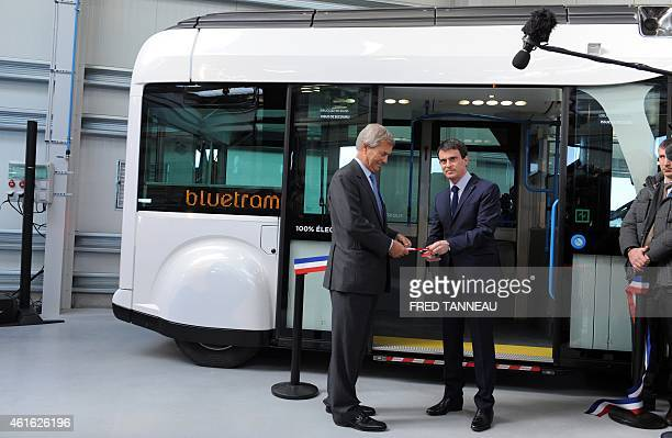 French Prime minister Manuel Valls and CEO Vincent Bollore inaugurate the Bollore's group 'Blue Tram' electric tramway factory on January 16 2015 in...